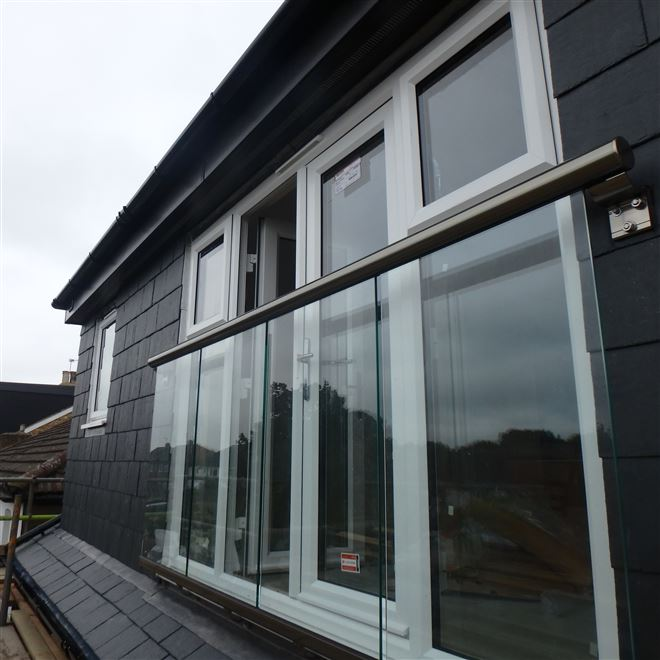 Dormer loft conversion in West Ealing W13 by Ash Island Lofts with glass balcony