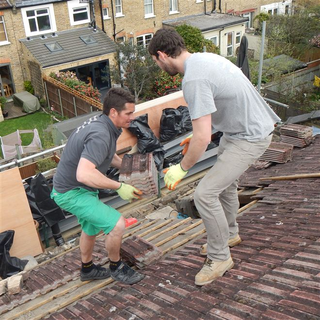 Hayden and Billy stripping the back roof at the loft conversion in Ealing