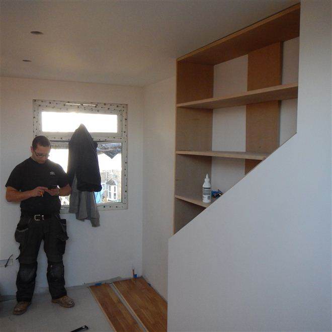Aaron from Ash Island Lofts building custom fitted cupboards to loft conversion in Ealing West London