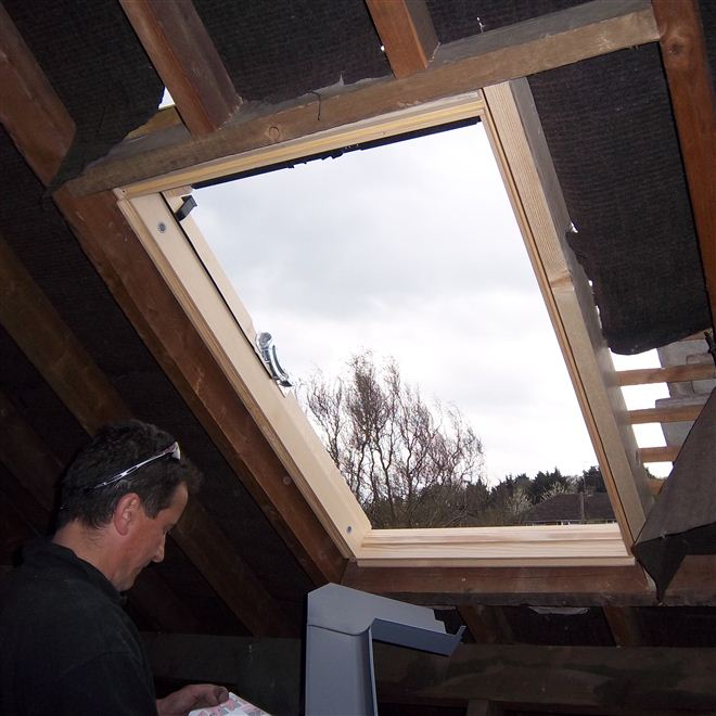 Velux window being fitted on loft conversion