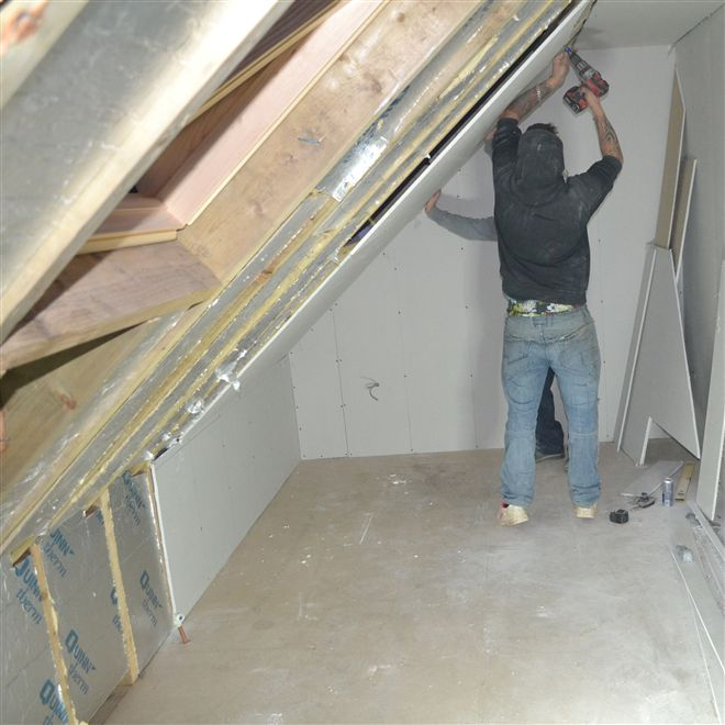 Plasterboarding at a loft conversion in High Wycombe.