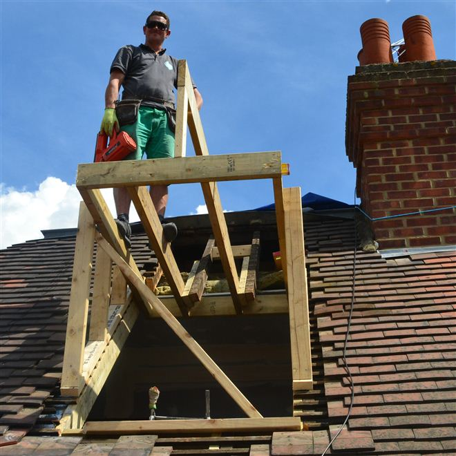 Hayden building a pitched roof dormer.