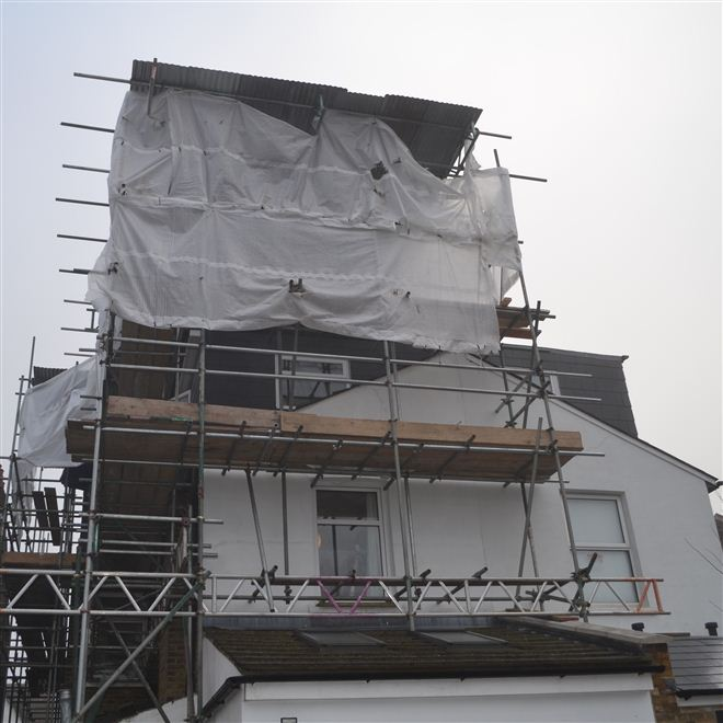 Tin hat scaffolding in Ealing for L Shaped dormer loft conversion into 2 bedrooms and bathroom by the loft conversion specialists Ash Island Lofts Limited