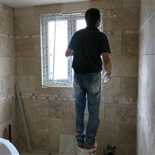 Phil tiling in Isleworth... the plumbers are coming tomorrow but it is going to be done and ready for them he says!