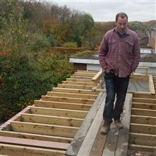 Claudiu fitting the flat roof joists.