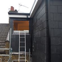 L Shaped dormer conversion in Chiswick W4 in slate ready for timber sash window to be fitted