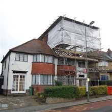 Tin hat scaffolding was needed on this loft conversion and reroofing job in Cheam.
