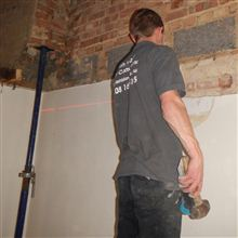 Paul cutting the pockets for the spreader plates at the Egham loft conversion
