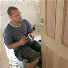 Aron here hanging the bathroom door in Isleworth