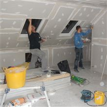Dorin and Stefan tape and jointing at this dormer loft conversion in Brentford.