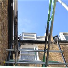 Mansard loft conversion in Shepherds Bush W12 with leaded dormers and Spanish slate tiles by Ash island Lofts