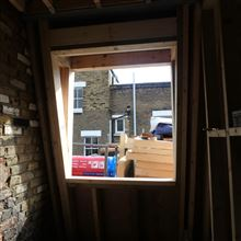 Mansard timber casement window over the stairwell in SW6 7JZ