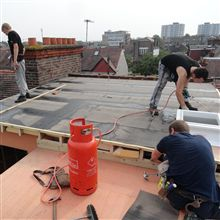 Torch on flat roofing in Wimbledon.