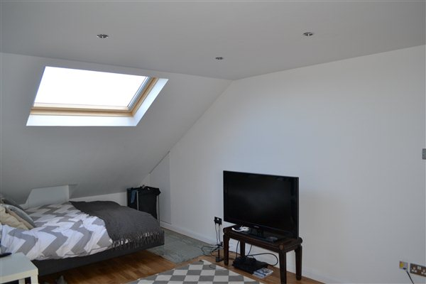 L shaped dormer into 2 bedrooms and bathroom all finished and decorated in Ealing