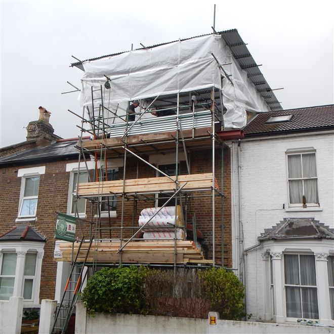Dormer loft conversion in Shepherds Bush W12 started January 2014 with tin hat scaffolding by Ash Island Lofts of Chiswick