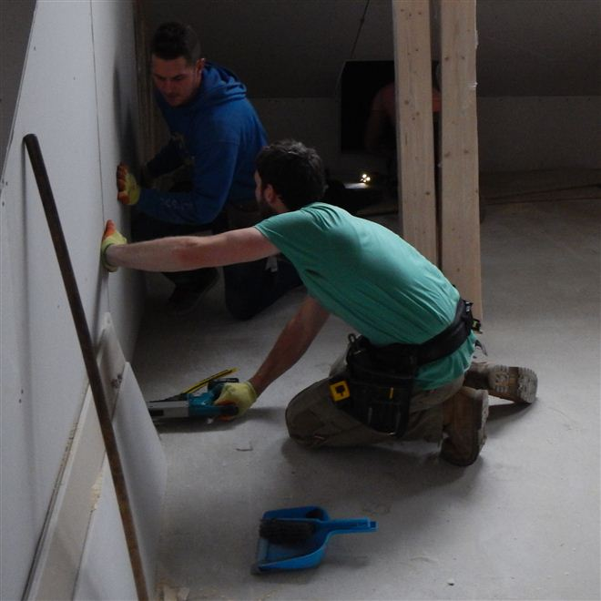 Hayden and Dylan plasterboarding at our current loft conversion in Ealing