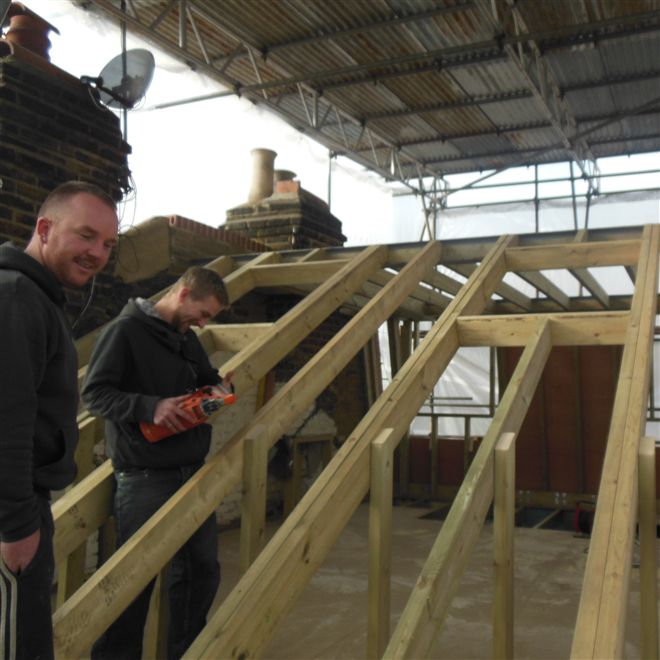 Anthony and Paul in Short Road, Chiswick putting in the new rafters on the front roof elevation.