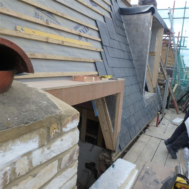 Tiling the side of this double mansard with spanish slates in Fulham - SW6