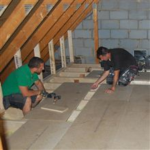 Aron and Eddie fitting chipboard flooring on this loft conversion