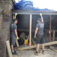 Fitting the ridge steel at the Ealing loft conversion