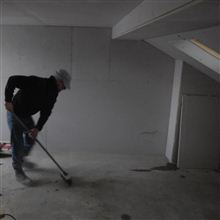 Paul from Ash Island lofts sweeping up and keeping the site tidy