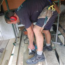Locky cutting timber at our recent Wimbledon SW19 loft conversion.