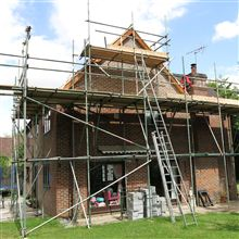 Scaffolding to brick up a gable end during a loft conversion