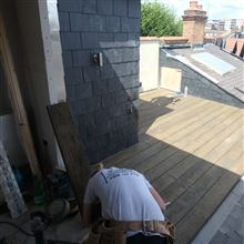 Nathan finishing the boards for the roof terrace in Chiswick W4