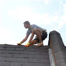 Nathan from Ash Island Lofts stripping a roof in Shepherds Bush W12