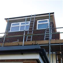 Boxed dormer with hanging tiles in Feltham by Ash Island Lofts of Chiswick.