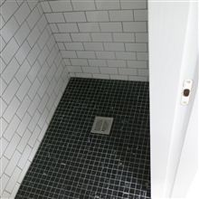 Wet room in loft conversion in Chiswick W4 by Ash Island Lofts with floor to ceiling tiles