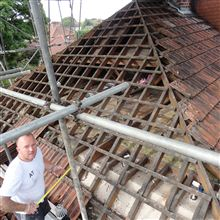 Roof tiles being taken off